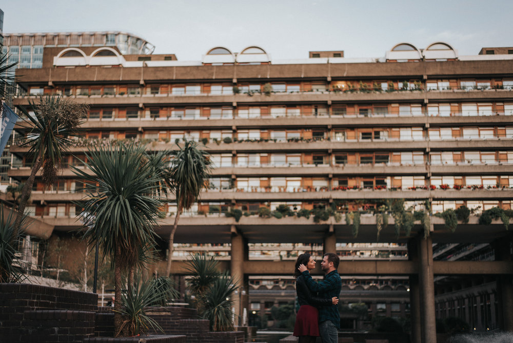 Creative Barbican Centre Engagement Photoshoot. Couple outside the barbican centre flats.