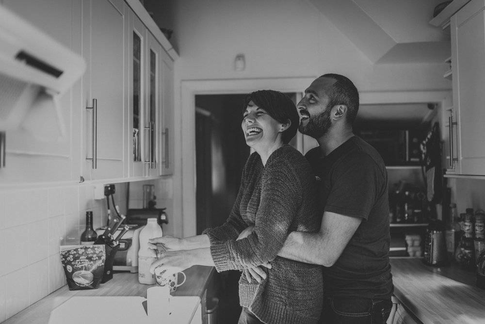 Quirky couples engagement shoot enjoying making a couple of tea at home