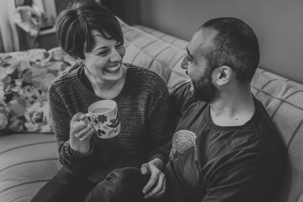 Couple engagement shoot drinking tea
