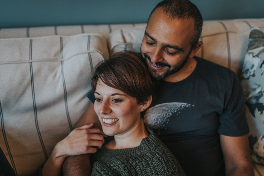 quirky engagement shoot with couple on the sofa