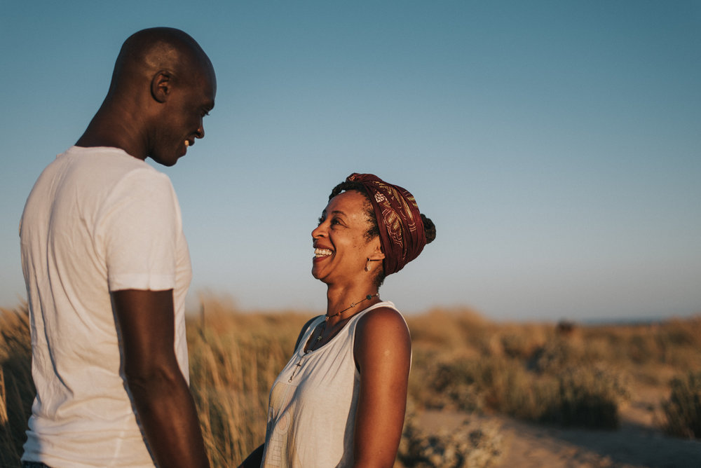 Couple smiling at each other in sand dunes, spain