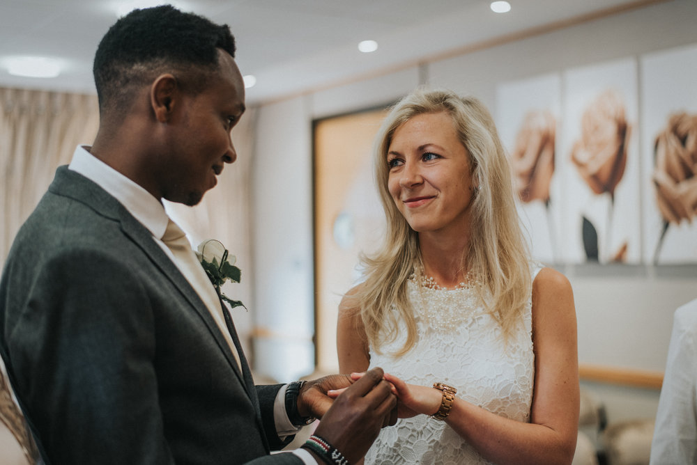couple exchanging rings at bromley engagement office