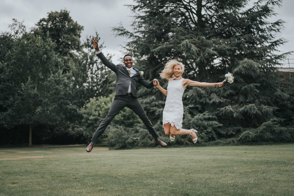 Couple jumping for joy on their wedding day