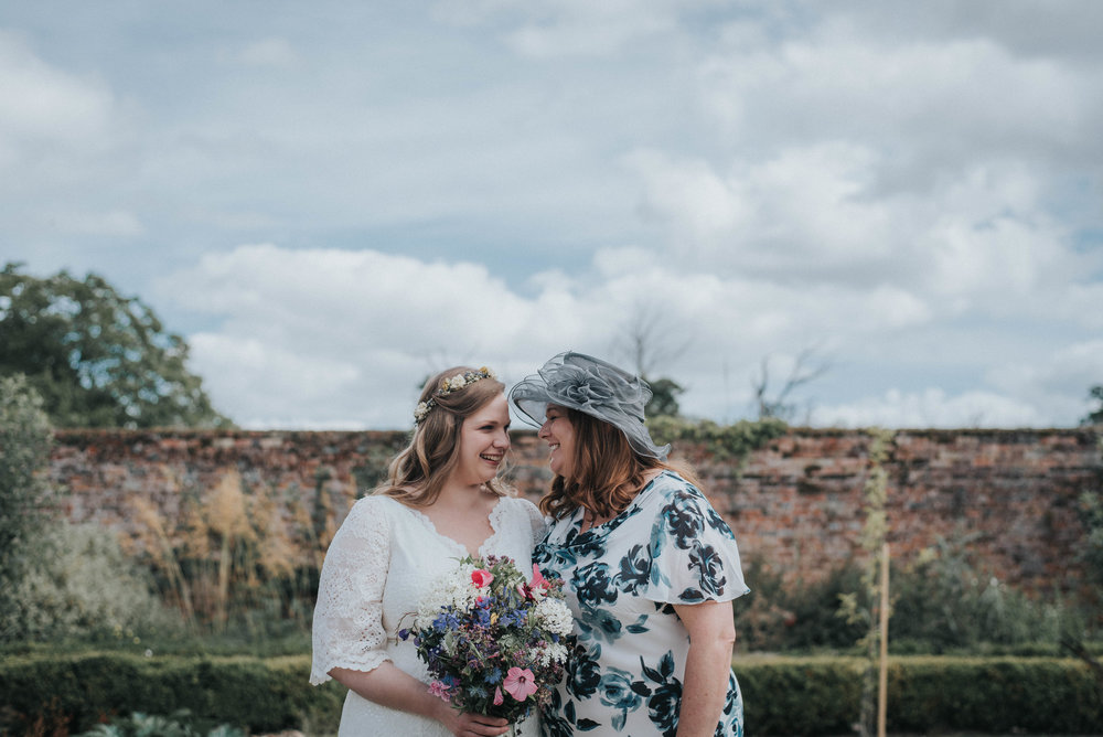 Mother laughing with her daughter at her Secret Garden Wedding in kent