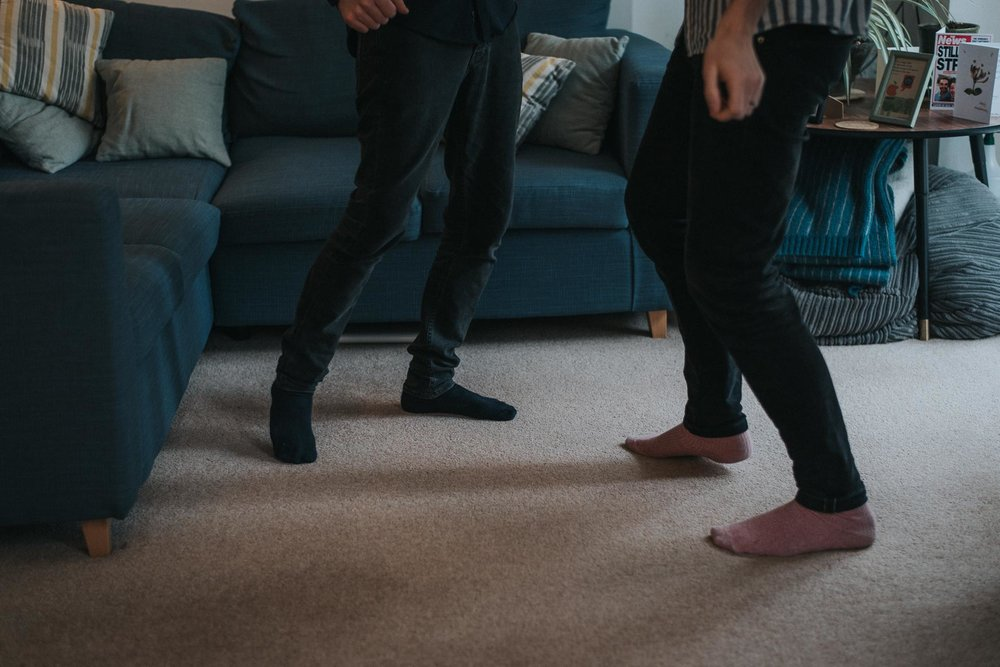 Couple dancing during their cosy at home london engagement shoot