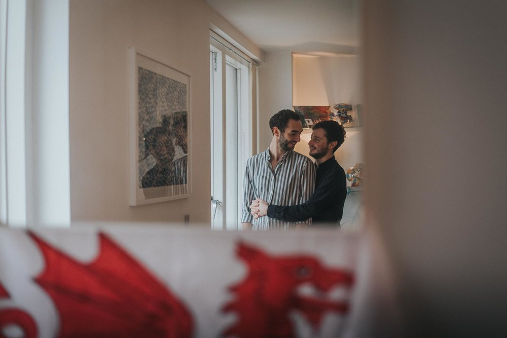 Couple romantically holding each other during their cosy at home london engagement shoot