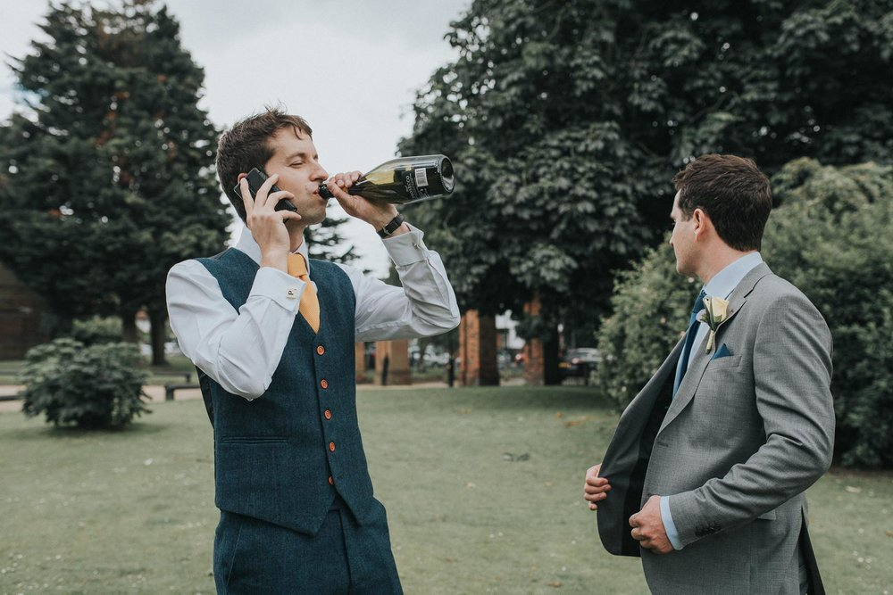 Groom pre-drinking at his fun & creative London wedding.  www.baiandelle.com