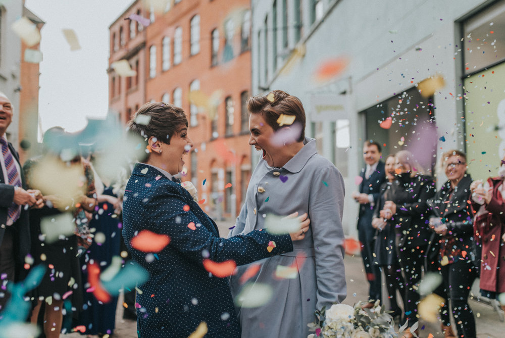 Confetti run with two brides | Alternative Birmingham Wedding photography.  www.baiandelle.com