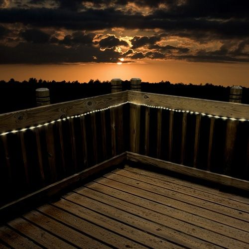 These  string lights  add sparkle to a simple wood deck, plus they are long-lasting LEDs powered by solar energy.