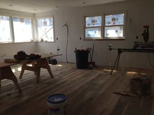 Work-in-progress. Better back yard views from our new kitchen and a glimpse of the wide-planked, softwood floors.