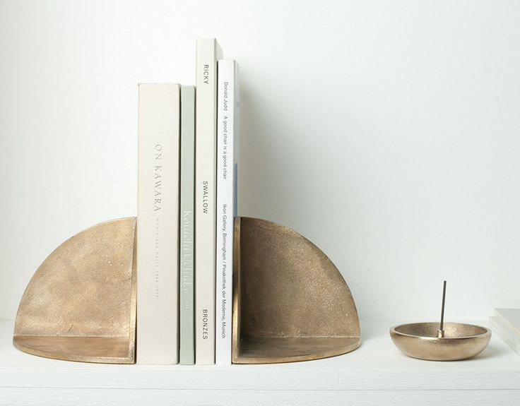 Brass or textural ceramic? Bookends available at The Future Perfect