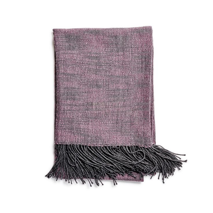 Also made in Peru, the Noe throw from Sefte is woven from two hues of organic alpaca to imitate linen.  via  abchome.com