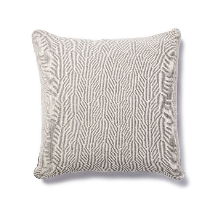 The knitted Kimsa pillow from Sefte resembles faux bois.  via  abchome.com