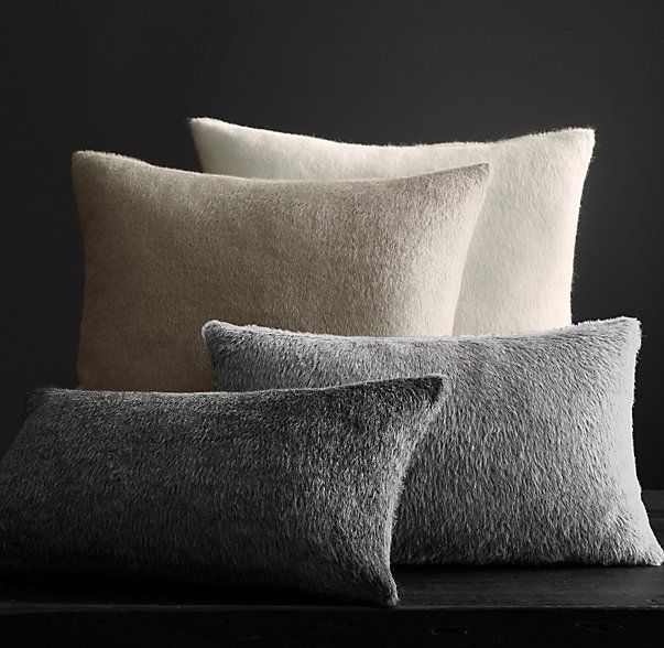 Restoration Hardware keeps their alpaca pillow covers shaggy but short, neutral and undyed, blended with a small amount of sheep wool.  via  restorationhardware.com