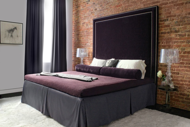 I used a deep, alpaca rug in my client's master bedroom as a soft and sexy contrast to the plush eggplant velvet headboard. via  tamarahubinskyinteriors.com