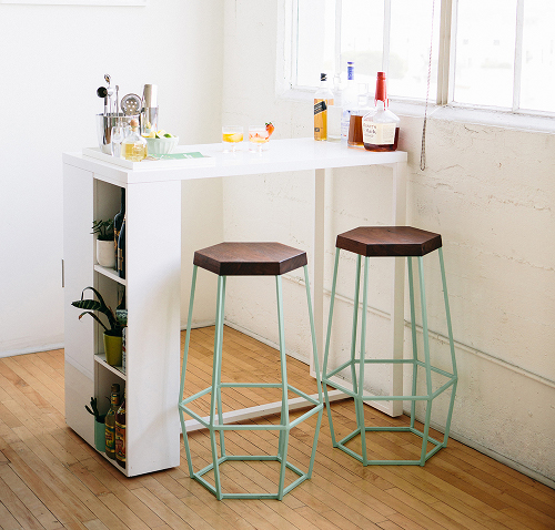 Light but Sturdy Hexagonal Stools easily tuck under counter.  via  haytherehome.com