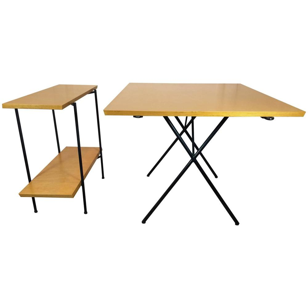 A extendable dining table and folding server. Designed by Tony Paul in the 1950s, the shelves of the server are the extra leaves for the dining table. The server folds when not in use.
