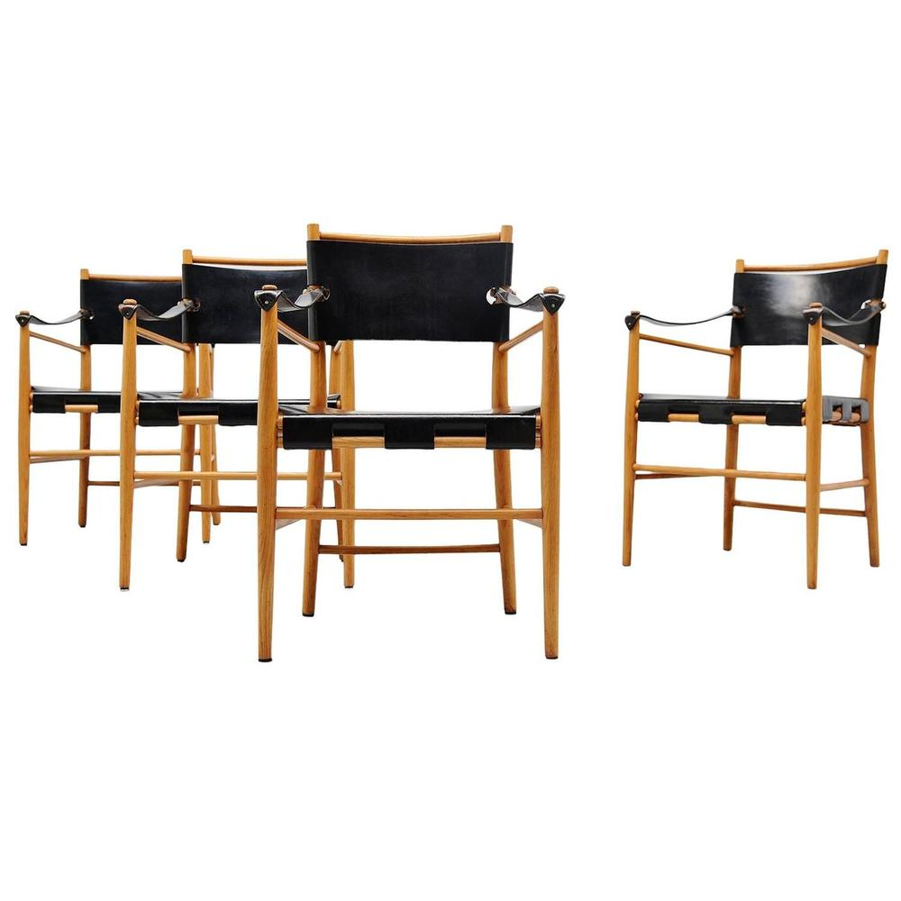 These  safari chairs , in birch and black leather from Italy, circa 1960 are simply sexy.