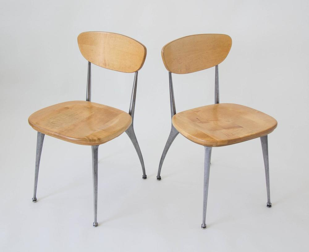 Simple and mass manufactured  gazelle leg chairs , American made by Shelby Williams in the 1950s. The simple curve of the aluminum leg is a nice compliment to the plainspoken, school house style birch chairs.
