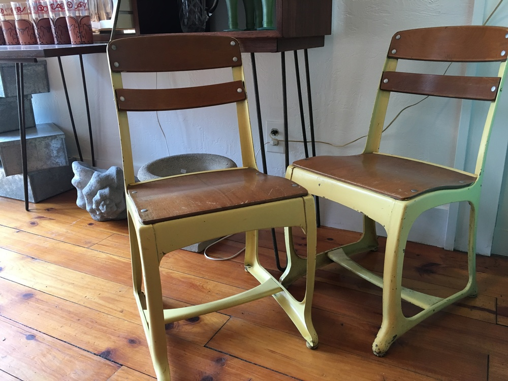 The powder yellow paint sets off schoolhouse chairs