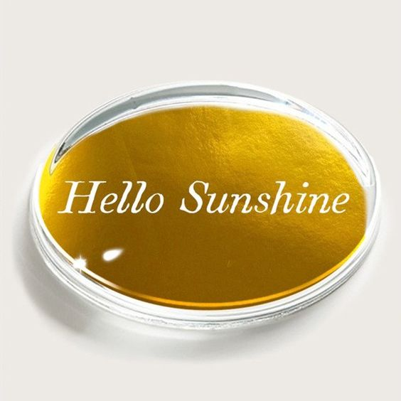 Paper weights can be hum drum and serious, but this one would make me happy everyday! Hello Sunshine from the  Museum of Art and Design .