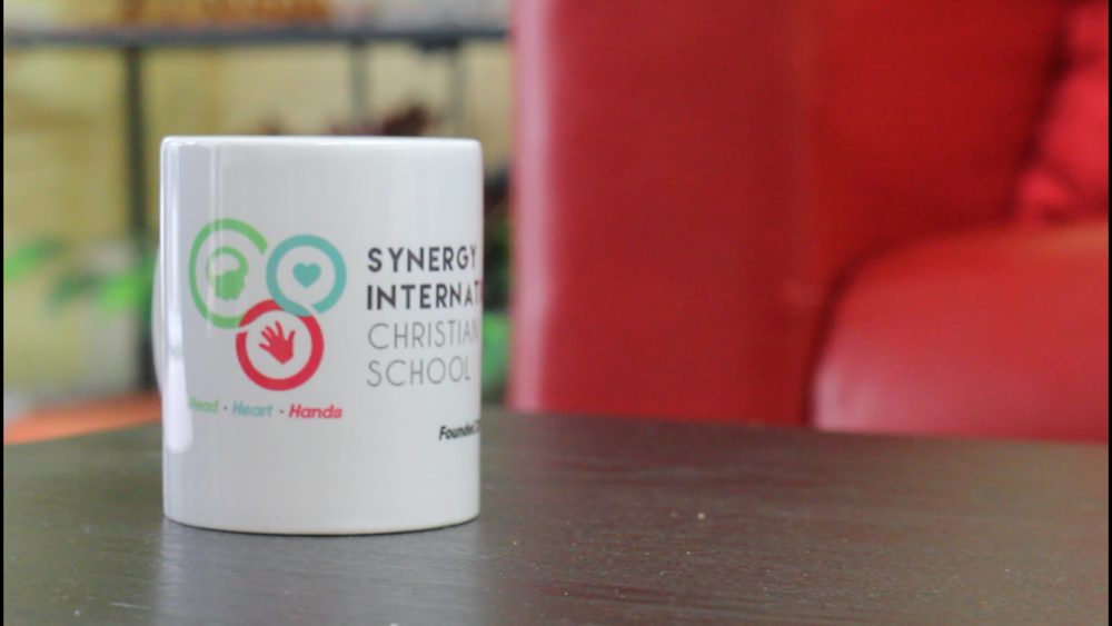 Synergy School Coffee mug logo branding