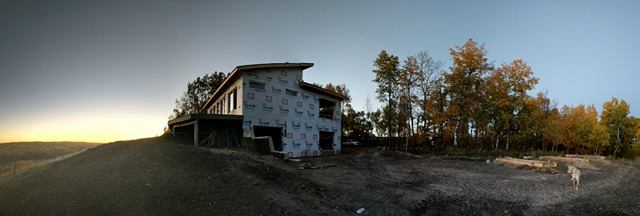 East side of the house overlooking the future off-grid solar system forms being prepared for concrete (right side).