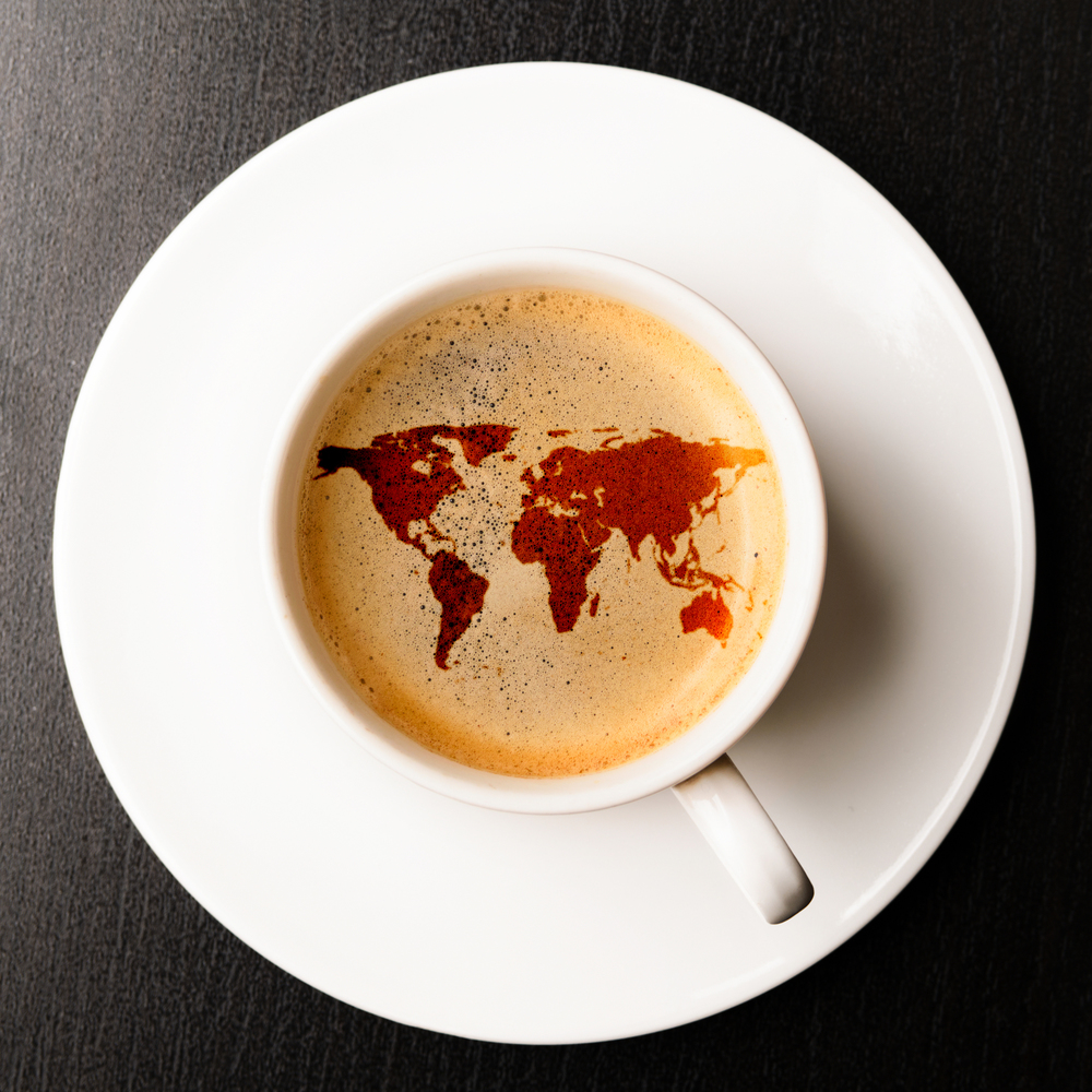 stock-photo-cup-of-fresh-espresso-on-table-view-from-above-earth-silhouette-is-from-visibleearth-nasa-gov-139023143.jpg
