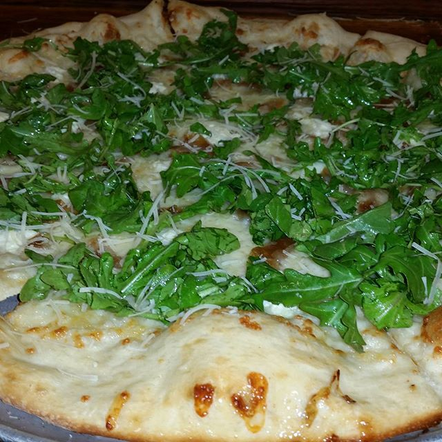 Garlic olive oil base, Carmelized onion and  Ricotta topped with balsamic arugula. #martollissouth