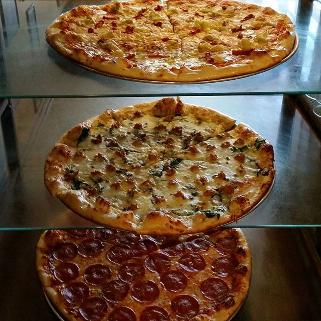 Always something amazing on display #martollispizza #pizza #ashland #freshslices