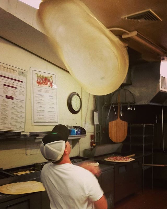We're awesome, cause we toss em! #pizza #artandpizza #martollispizza #toss #fun