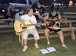 Guitars by the campfire