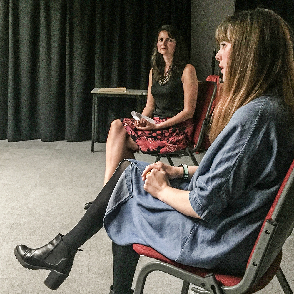 Exposition Space artist Jessica Akerman (foreground) and guest curator Dr. Irene Noy onstage during the private view artist talk for her exhibition, July 2016.