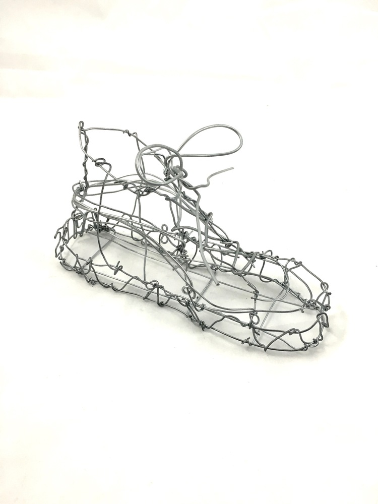 Wire shoe  This shoe is loosely based off of a Vans shoe, but is half the size