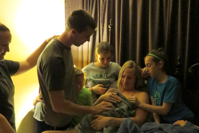 Dad leading everyone in prayer, thanking God for Emalynn's safe birth