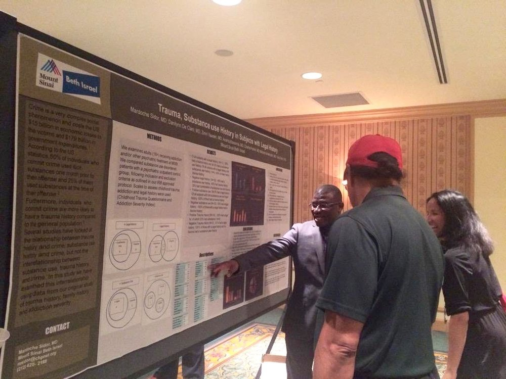 APA Fellowships on Twitter- %22#APA MFP fellow Dr. Mardoche Sidor explains his poster to long time MFP mentor Dr. Carl Bell. #apaam15 (1).jpg
