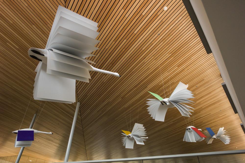 """Flight of Imagination"" 2015  Aluminum, foam, 7 life sized swans  Mendenhall Library"