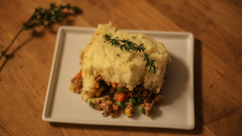 "Happy New Year!!!  It is officially January and the cold/rainy weather has really started to kick in (even out here in California).  So, we are kicking off 2017 with a cozy and perfect winter weather dish - Homemade Shepherd's Pie.  This recipe is inspired by our recent trip to Scotland (where Alec's family is from).  Shepherd's Pie is a Scottish dish using lamb- not to be confused with ""Cottage Pie"" which uses beef.  Historically, Shepherd's Pie was a meal thrown together using leftovers and whatever vegetables were accessible- so feel free to get creative and add in whatever favorite veggies you have at home. And because it is loaded with so many delicious veggies,  this recipes can also be easily made into a vegetarian dish by simply removing the lamb and replacing the chicken broth with vegetable broth.  We hope you enjoy this as much as we do!   CLICK HERE FOR FULL RECIPE"