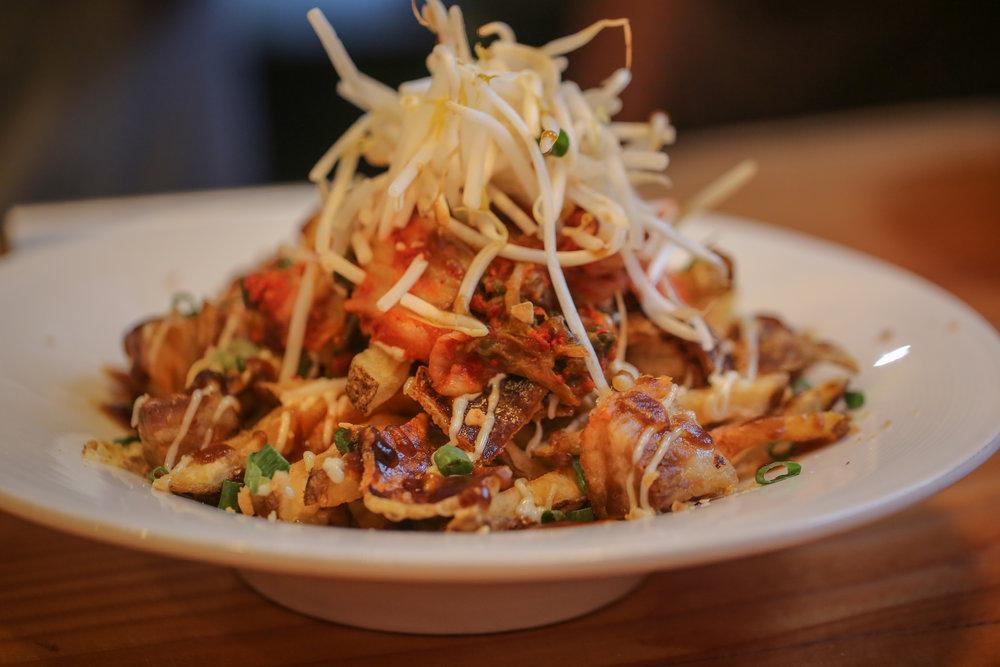 Kimchi Fries- crispy pork belly, double fried kennebec fries, housemade kimchi, bean sprout, sweet tamari, and crispy garlic
