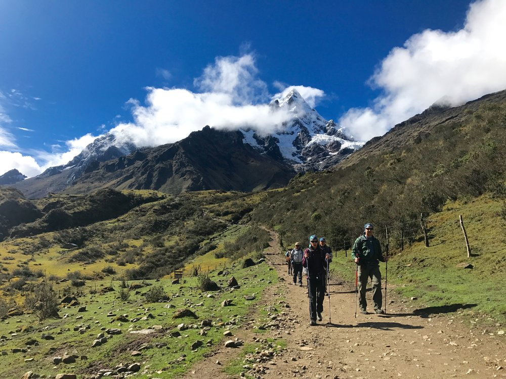 Travelers hiking down from the peak, Salkantay Trek, Peru 2017