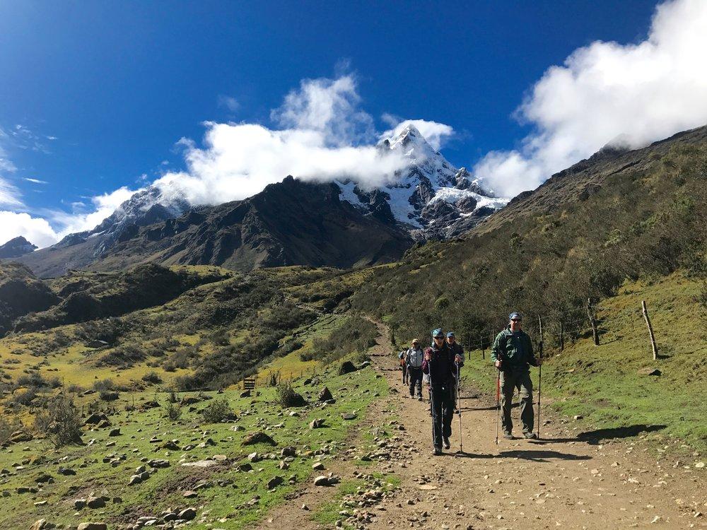 Travelers hiking down from the peak, Salkantay Trek, Peru 2017