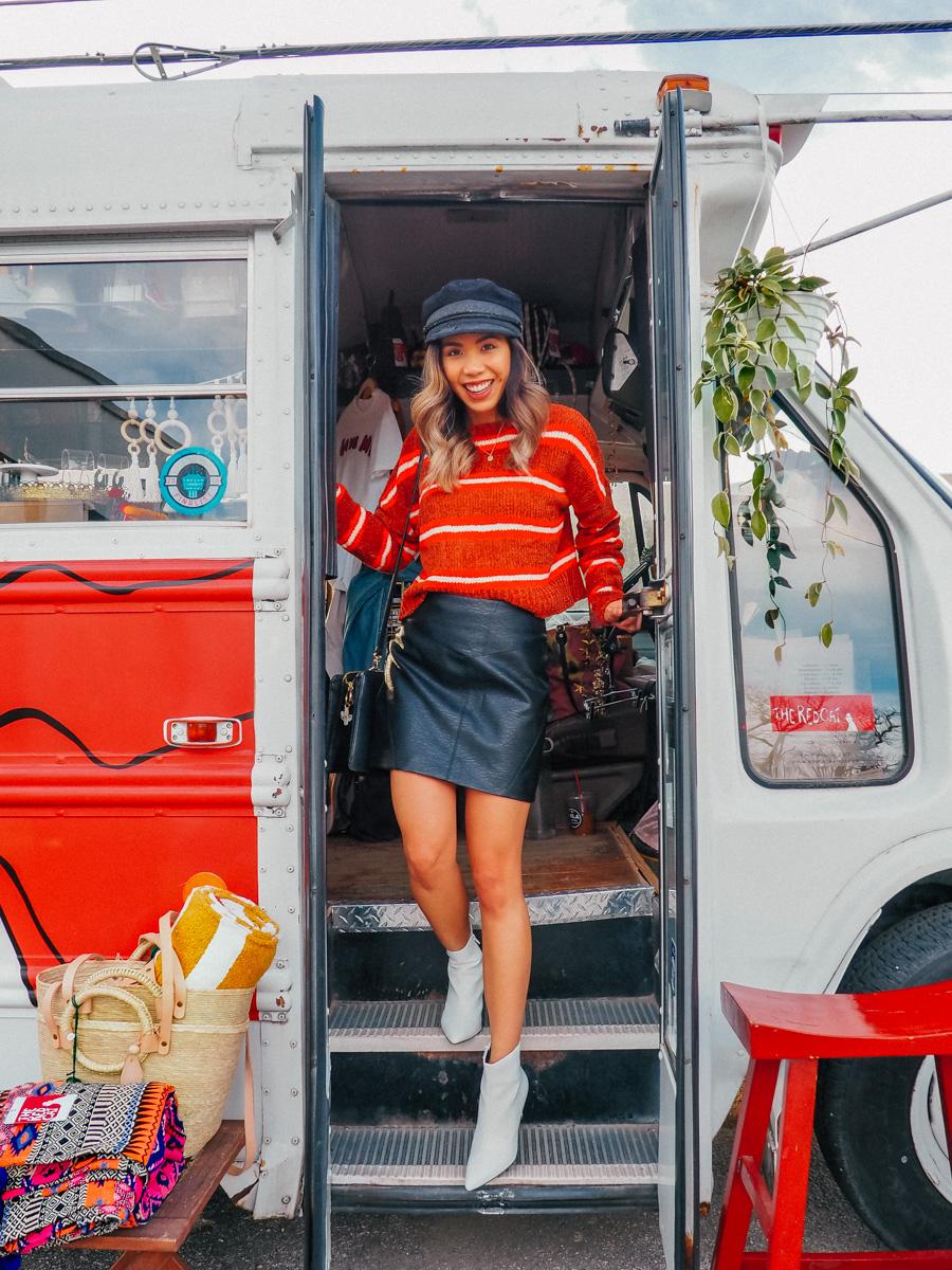 travel blogger inside the Red Cat retail bus in san antonio