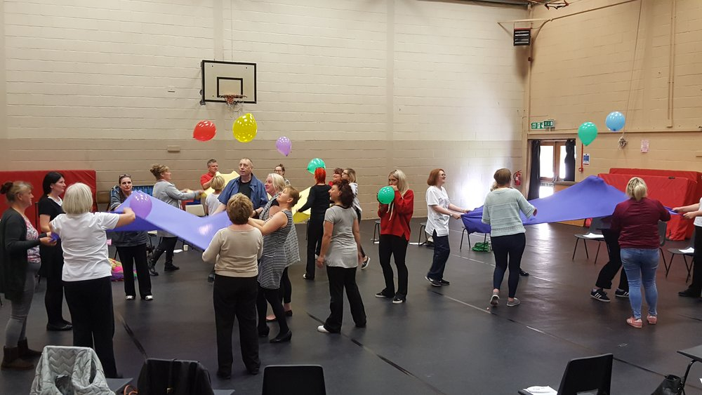 Some of the participants exploring props during a LOVE/LIFE session in Fife.