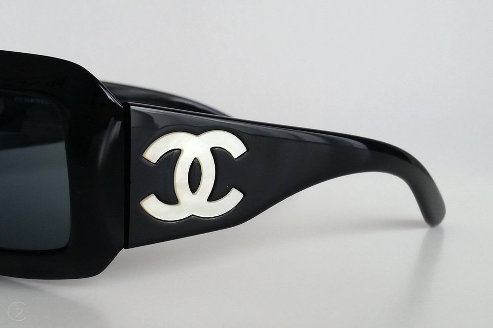 character-32-lifestyle-designer-chanel-sunglasses-up-close-black-and-pearl