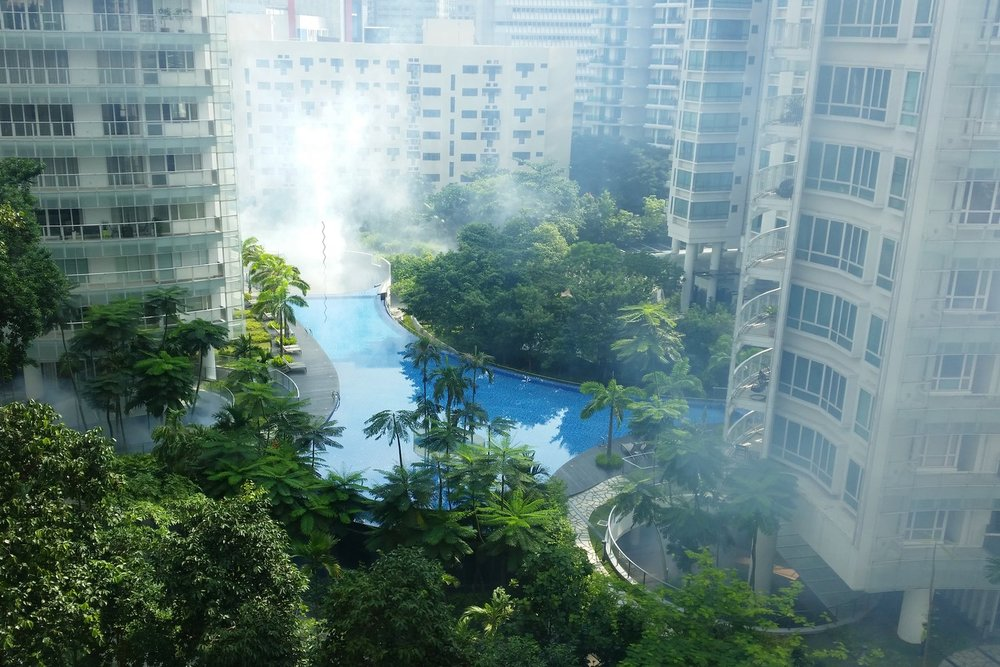 The condo opposite my apartment getting it's weekly fogging for mosquitoes.