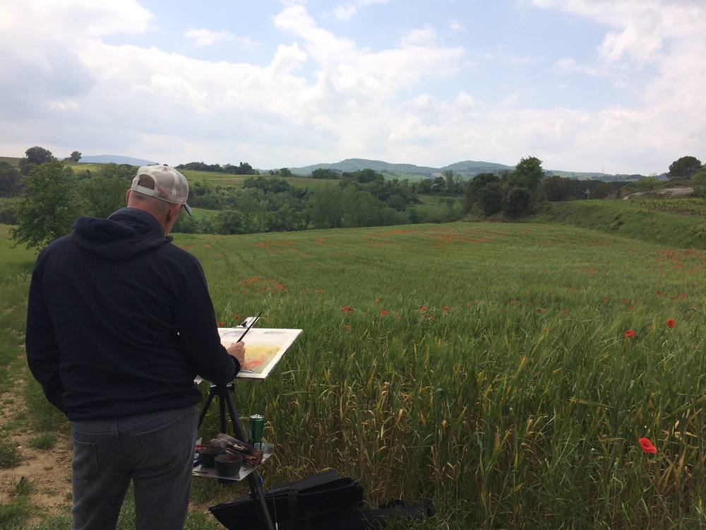 Painting in the poppy fields near Limoux, France