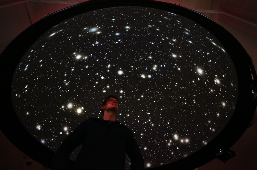 A visitor underneath the 'Black Shoals: Dark Matter' - a stock market planetarium created by Lise Autogena and Joshua Portway at the Big Bang Data exhibition at Somerset House on December 2, 2015 in London, England.   (Photo by Peter Macdiarmid/Getty Images for Somerset House)