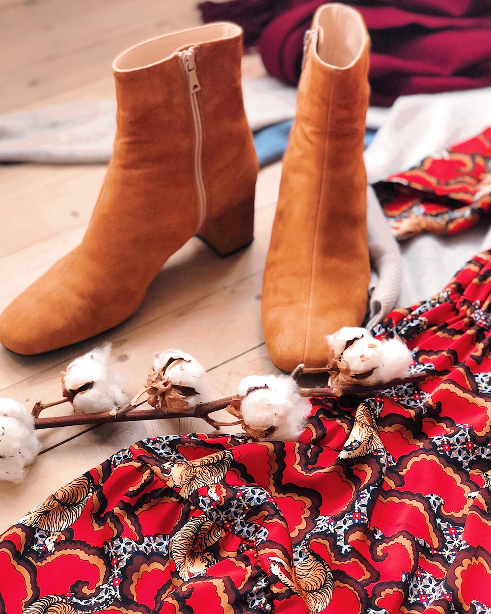 The printed, red dress from Sandro Paris was found via Vestiaire Collective, while the boots from Notabene were purchased via Tradono. Cashmere knits and scarf (in the background) are flea market finds.