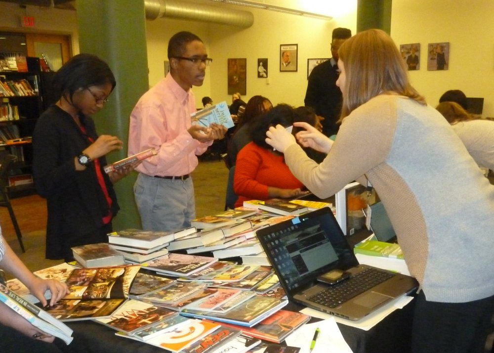 Students sign up for Carnegie Library of Pittsburgh library cards.