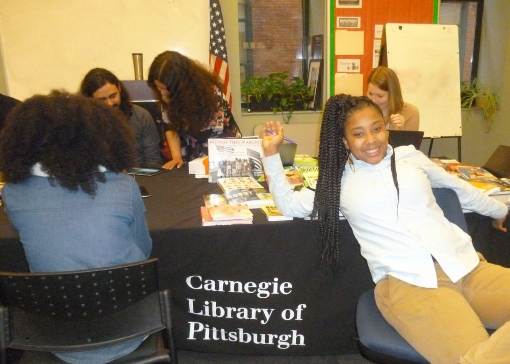 Carnegie Library of Pittsburgh representatives bring new titles for Urban Pathways students to check out.